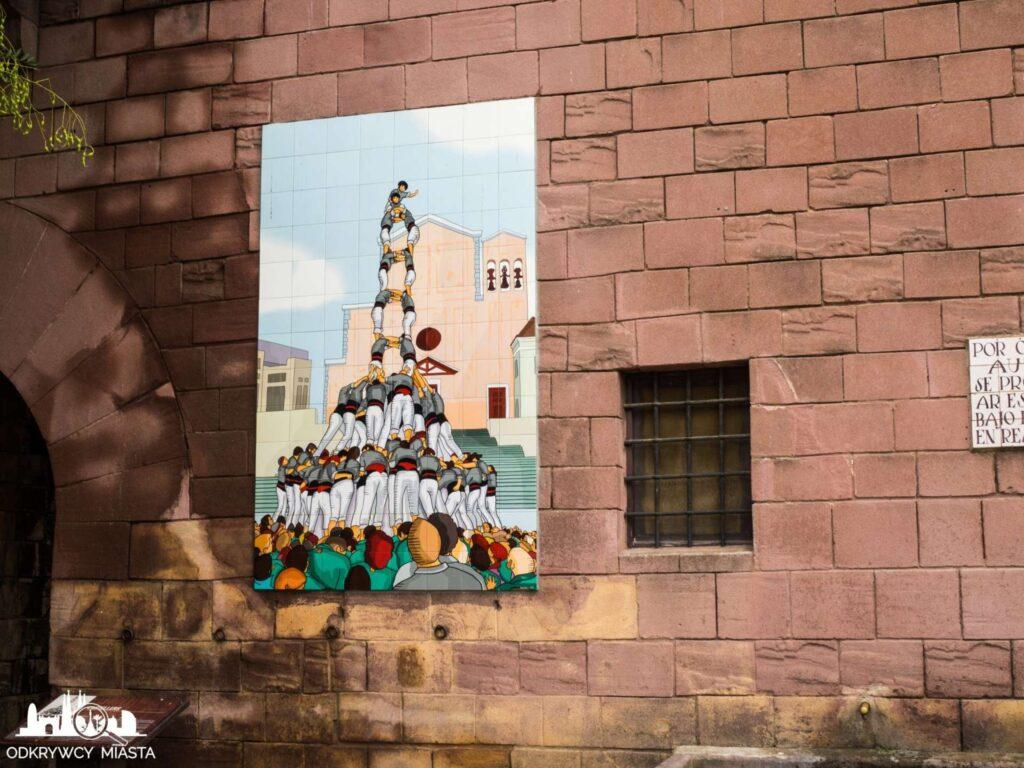 Poble espanol plakat z castellers (wieżą z ludzi)