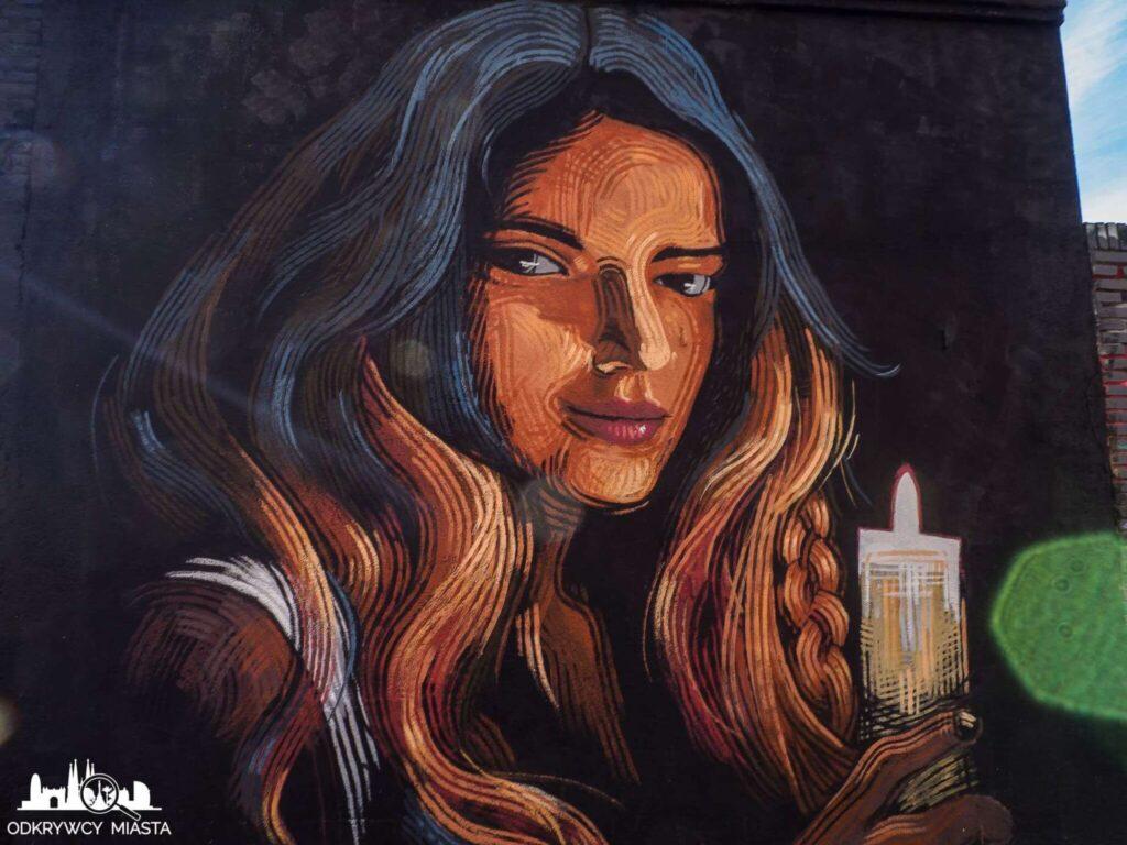 Street Art Barcelona park grafik kobieta ze świecą