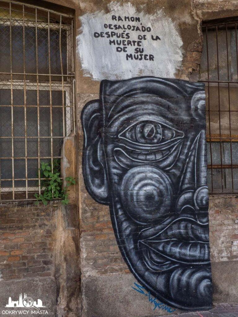 Street Art Barcelona park grafik twarz na ścianie budynku
